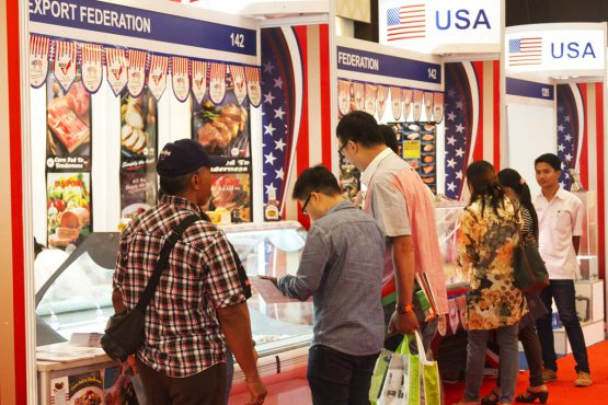 Food, Hotel & Tourism Bali: Visitors viewing premium US meat products.