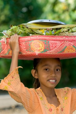 Traditional Indonesian Girl Carrying Produce on her head